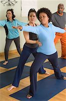 fitness older women gym - Yoga Instructor Assisting Woman in Yoga Class Stock Photo - Premium Royalty-Freenull, Code: 693-06018275