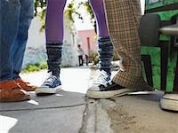 Teenage Friends on Sidewalk Stock Photo - Premium Royalty-Freenull, Code: 693-06018429