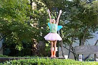 preteen girls stretching - Girl wearing tutu and fairy wings playing in park Stock Photo - Premium Royalty-Freenull, Code: 693-06018457