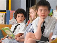 Elementary students reading books, sitting in classroom Stock Photo - Premium Royalty-Freenull, Code: 693-06018558
