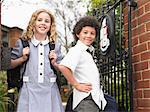 Two elementary students standing at school gate, portrait Stock Photo - Premium Royalty-Free, Artist: R. Ian Lloyd, Code: 693-06018561