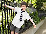 School boy hanging off iron fence Stock Photo - Premium Royalty-Free, Artist: CulturaRM, Code: 693-06018563