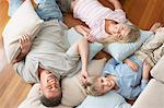 Father and Children Lying on pillows and cushions on wood Floor, overhead view Stock Photo - Premium Royalty-Free, Artist: Siephoto, Code: 693-06018585