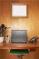 potted plant - Laptop and other items on desk, framed graph above desk Stock Photo - Premium Royalty-Freenull, Code: 693-06018675