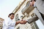 Two Businessmen Shaking Hands Stock Photo - Premium Royalty-Free, Artist: GreatStock, Code: 693-06018725