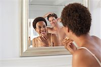 Couple Using Bathroom Mirror Stock Photo - Premium Royalty-Freenull, Code: 693-06018839