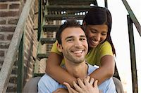 Young Couple on Fire Escape Stock Photo - Premium Royalty-Freenull, Code: 693-06018855
