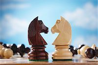 strategy - Chess pieces, two knights face to face Stock Photo - Premium Royalty-Freenull, Code: 693-06018917