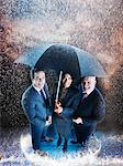 Businesspeople under one umbrella Stock Photo - Premium Royalty-Free, Artist: Robert Harding Images, Code: 693-06018983