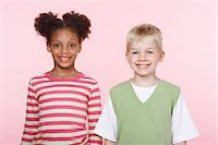 Smiling Girl and Boy Side by Side Stock Photo - Premium Royalty-Freenull, Code: 693-06019077