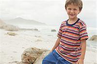 preteen  smile  one  alone - Smiling Boy on Beach Stock Photo - Premium Royalty-Freenull, Code: 693-06019153