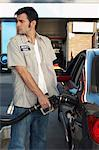Service attendant pumping gas Stock Photo - Premium Royalty-Free, Artist: Marc Simon, Code: 693-06019257