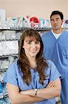Female and male nurse standing by shelves with medical supply, portrait Stock Photo - Premium Royalty-Free, Artist: photo division, Code: 693-06019271