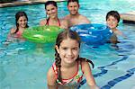 Family with two girls and boy with inflatable rafts, in swimming pool,  portrait Stock Photo - Premium Royalty-Free, Artist: dk & dennie cody, Code: 693-06019367
