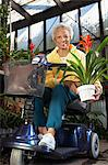 Senior woman on motor scooter in garden center Stock Photo - Premium Royalty-Free, Artist: Glowimages               , Code: 693-06019428