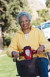 Senior woman on motor scooter on urban street Stock Photo - Premium Royalty-Free, Artist: Susan Findlay, Code: 693-06019433