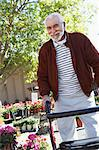 Elderly man with walking frame in garden center Stock Photo - Premium Royalty-Free, Artist: Robert Harding Images, Code: 693-06019436
