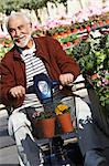 Elderly man on motor scooter in garden center Stock Photo - Premium Royalty-Free, Artist: Robert Harding Images, Code: 693-06019437
