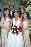 Portrait of girl (13-15) with parents and friends in garden at Quinceanera Stock Photo - Premium Royalty-Free, Artist: Blend Images, Code: 693-06019472