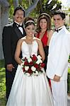 Portrait of couple (13-15) with parents at Quinceanera Stock Photo - Premium Royalty-Free, Artist: Blend Images, Code: 693-06019473