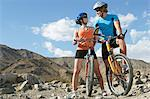 Young couple on bicycles in mountains Stock Photo - Premium Royalty-Free, Artist: Ron Fehling, Code: 693-06019494