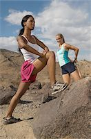 Two female joggers stretching in mountains Stock Photo - Premium Royalty-Freenull, Code: 693-06019503