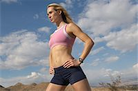 Female jogger with hands on hips, outdoors Stock Photo - Premium Royalty-Freenull, Code: 693-06019505