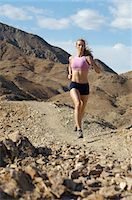 Young woman jogging in mountains Stock Photo - Premium Royalty-Freenull, Code: 693-06019506