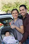 Portrait of couple with baby (1-6 months) in carrier by car Stock Photo - Premium Royalty-Free, Artist: dk & dennie cody, Code: 693-06019571