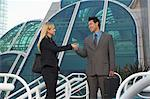 Businessman and woman shaking hands in front of office building Stock Photo - Premium Royalty-Free, Artist: Cultura RM, Code: 693-06019634