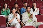People sitting in auditorium and clapping hands Stock Photo - Premium Royalty-Free, Artist: Blend Images, Code: 693-06019712