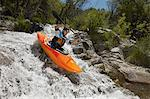 Man kayaking on mountain river Stock Photo - Premium Royalty-Free, Artist: Blend Images, Code: 693-06019746