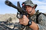 Soldier aiming machine gun, close-up Stock Photo - Premium Royalty-Free, Artist: Kablonk! RM, Code: 693-06019815