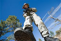 Low angle portrait of armed soldier Stock Photo - Premium Royalty-Freenull, Code: 693-06019817