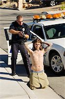 restrained - Police Officer Arresting Young Man Stock Photo - Premium Royalty-Freenull, Code: 693-06019837