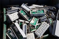 Pile of old electronic components in bin Stock Photo - Premium Royalty-Freenull, Code: 693-06019883