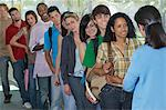Row of students and teacher in school Stock Photo - Premium Royalty-Free, Artist: Blend Images, Code: 693-06019896
