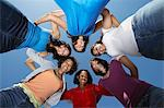 Young women standing in circle, view from below Stock Photo - Premium Royalty-Free, Artist: CulturaRM, Code: 693-06019908