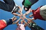 Group of young people in circle, view from below Stock Photo - Premium Royalty-Free, Artist: CulturaRM, Code: 693-06019914