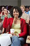 Group of people in classroom, one woman with raised arm Stock Photo - Premium Royalty-Free, Artist: Blend Images, Code: 693-06019919