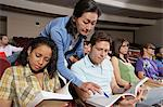 Female teacher assisting students during lesson Stock Photo - Premium Royalty-Free, Artist: Cultura RM, Code: 693-06019925