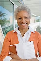 Woman embracing book at school, portrait Stock Photo - Premium Royalty-Freenull, Code: 693-06019934