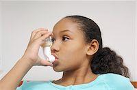Girl (7-9) using inhaler in hospital Stock Photo - Premium Royalty-Freenull, Code: 693-06019997