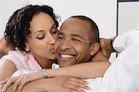Woman Kissing Smiling Man Stock Photo - Premium Royalty-Freenull, Code: 693-06020067