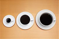 Three coffee cups of various sizes Stock Photo - Premium Royalty-Freenull, Code: 693-06020280