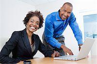 Businesspeople Using Laptop Stock Photo - Premium Royalty-Freenull, Code: 693-06020423