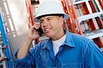 Worker Talking on Cell Phone Stock Photo - Premium Royalty-Freenull, Code: 693-06020522