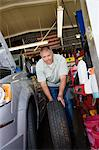 Auto Mechanic Changing a Tire Stock Photo - Premium Royalty-Free, Artist: Blend Images, Code: 693-06020531