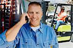 Workman Talking on a Cell Phone Stock Photo - Premium Royalty-Freenull, Code: 693-06020534
