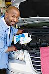 Auto Mechanic Adding Fluids to Minivan Stock Photo - Premium Royalty-Free, Artist: Blend Images, Code: 693-06020543